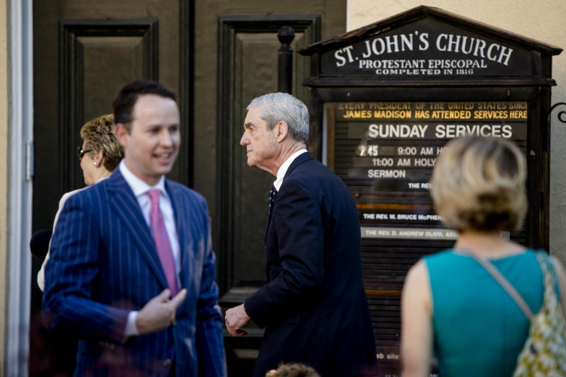 Special Counsel Robert Mueller, center, and his wife Ann Cabell Standish, left, arrive for Easter services at St. John's Episcopal Church, Sunday, April 21, 2019, in Washington. (AP Photo/Andrew Harnik)
