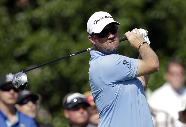 Peter Hanson, of Sweden, tees off of the 18th hole during the opening round of the Byron Nelson Championship golf tournament, Thursday, May 15, 2014, in Irving, Texas. Hanson finished the round at 5 under par. (AP Photo/Tony Gutierrez)