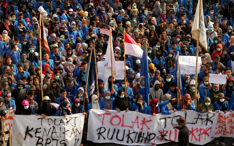 Students march towards the local parliament in Makassar, Sulawesi - REUTERS