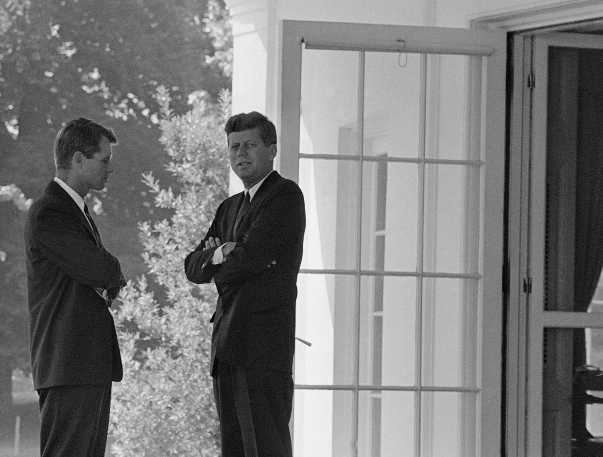 President John F. Kennedy, right, confers with his brother, Attorney General Robert F. Kennedy, at the White House in Washington, D.C., on Oct. 1, 1962, during the buildup of military tensions between the U.S. and the Soviet Union that became Cuban missile crisis later that month. (Photo: AP)