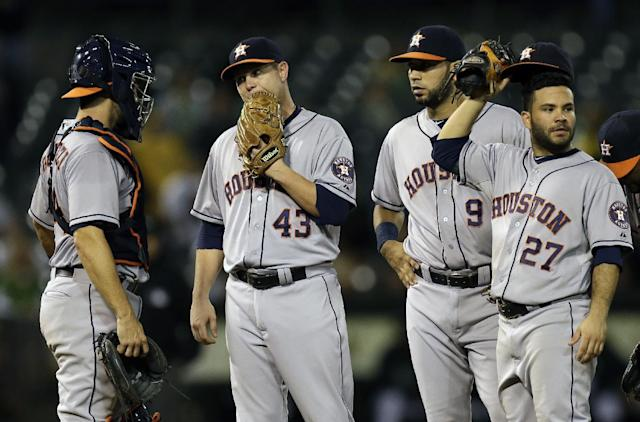 Houston Astros' Brad Peacock (43) is visited on the mound by teammates prior to being removed in the eighth inning of their baseball game against the Oakland Athletics on Thursday, Sept. 5, 2013, in Oakland, Calif. (AP Photo/Ben Margot)