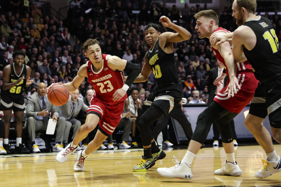 Wisconsin guard Kobe King (23) drives against Purdue guard Nojel Eastern (20) during the first half of an NCAA college basketball game in West Lafayette, Ind., Friday, Jan. 24, 2020. (AP Photo/Michael Conroy)