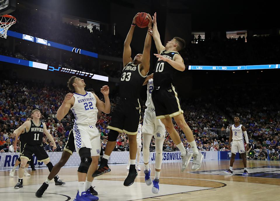 <p>Cameron Jackson #33 and Nathan Hoover #10 of the Wofford Terriers rebounds against Reid Travis #22 of the Kentucky Wildcats during the first half of the game in the second round of the 2019 NCAA Men's Basketball Tournament at Vystar Memorial Arena on March 23, 2019 in Jacksonville, Florida. (Photo by Sam Greenwood/Getty Images) </p>