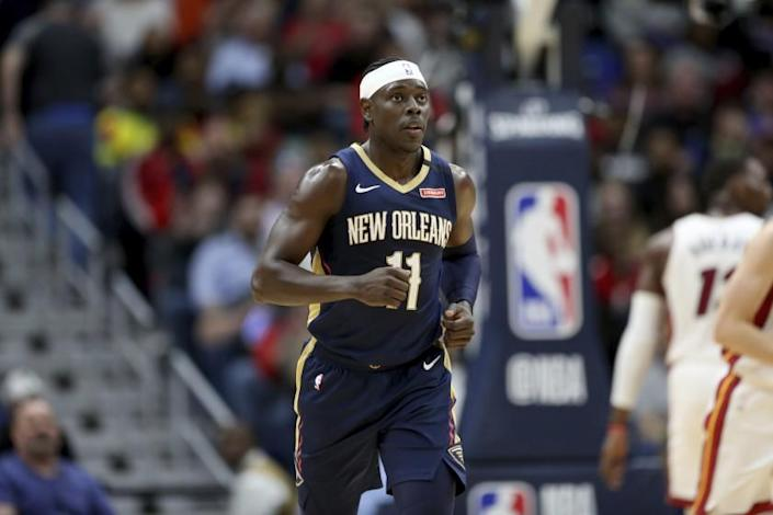 "New Orleans Pelicans guard Jrue Holiday runs up the court against the Miami Heat in New Orleans on March 6. <span class=""copyright"">(Rusty Costanza / Associated Press)</span>"