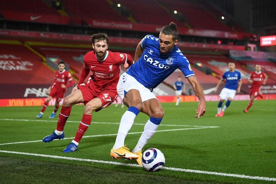 Dominic Calvert-Lewin in action under pressure from Nathaniel PhillipsGetty