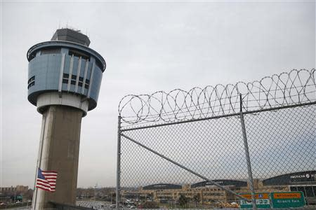 An air traffic control tower is seen at the central terminal of LaGuardia Airport in the Queens borough of New York April 8, 2014. REUTERS/Shannon Stapleton