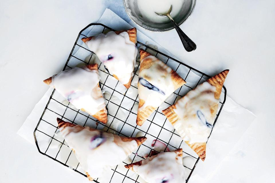 """When berries are in season, there's no better dessert than these adorable glazed triangles. <a href=""""https://www.epicurious.com/recipes/food/views/glazed-blueberry-blackberry-turnovers?mbid=synd_yahoo_rss"""" rel=""""nofollow noopener"""" target=""""_blank"""" data-ylk=""""slk:See recipe."""" class=""""link rapid-noclick-resp"""">See recipe.</a>"""