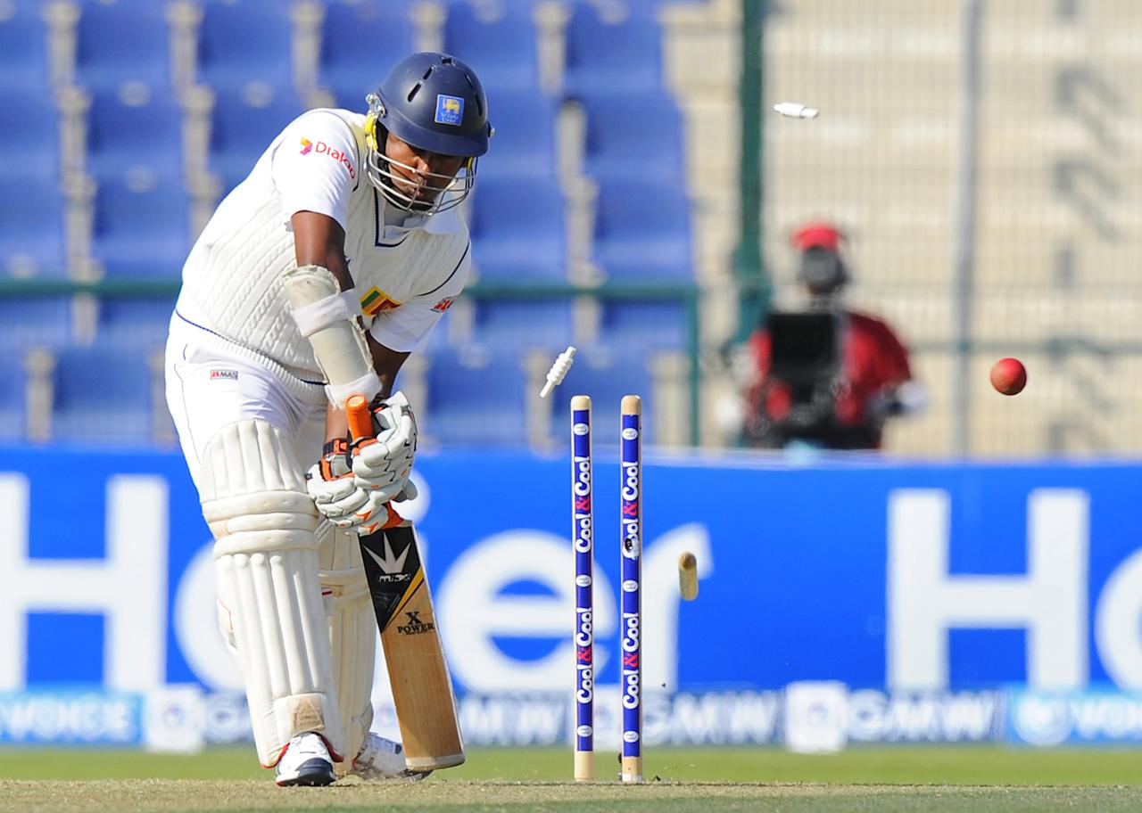 Sri Lankan batsman Rangana Herath is bowled out during the opening day of the first cricket Test match between Pakistan and Sri Lanka at the Sheikh Zayed Stadium in Abu Dhabi on December 31, 2013. AFP PHOTO/Ishara S. KODIKARA