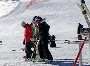 Lindsey Vonn is helped off the slope after Tuesday's crash. (AP)