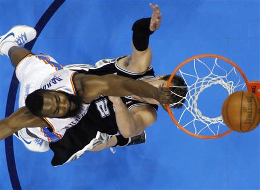Oklahoma City Thunder guard James Harden (13) shoots over San Antonio Spurs center Tiago Splitter, of Brazil, during the first half of Game 3 in their NBA basketball Western Conference finals playoff series, Thursday, May 31, 2012, in Oklahoma City. (AP Photo/Sue Ogrocki)