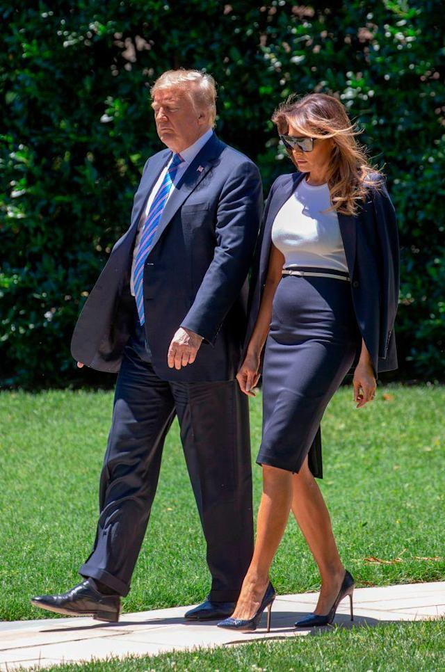 <p>The presidential couple departed the White House en route to Joint Base Andrews on 18 July. For the engagement, Melania opted for a navy-hued skirt suit. <em>[Photo: Getty]</em> </p>