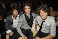 <p>Kevin Jonas (center) rose to fame alongside his brothers, Nick and Joe, in the Jonas Brothers. Along with their lucrative contract with Disney and appearances in films like <em>Camp Rock</em>, Kevin (and his brothers) were nominated for multiple Grammys. </p>