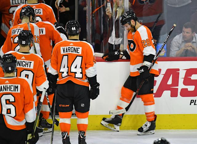 Apr 6, 2019; Philadelphia, PA, USA; Philadelphia Flyers center Claude Giroux (28) waits for his teammates to leave the ice after a loss to the Carolina Hurricanes in the final game of the season at Wells Fargo Center. Mandatory Credit: Eric Hartline-USA TODAY Sports