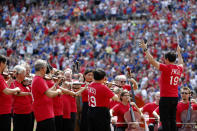 The Fort Worth Symphony Orchestra play the national anthem before a baseball game between the New York Yankees and the Texas Rangers in Arlington, Texas, Sunday, Sept. 29,2019. (AP Photo/Tony Gutierrez)