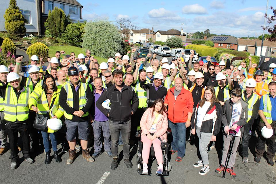 The McCreight family with the DIY SOS team and volunteers. (BBC/Hamish Summers)