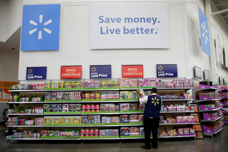 FILE- In this Nov. 9, 2017, file photo, a Walmart employee scans items while conducting an exercise during a Walmart Academy class session at the store in North Bergen, N.J. Walmart reports earnings on Thursday, Aug. 16, 2018. (AP Photo/Julio Cortez, File)