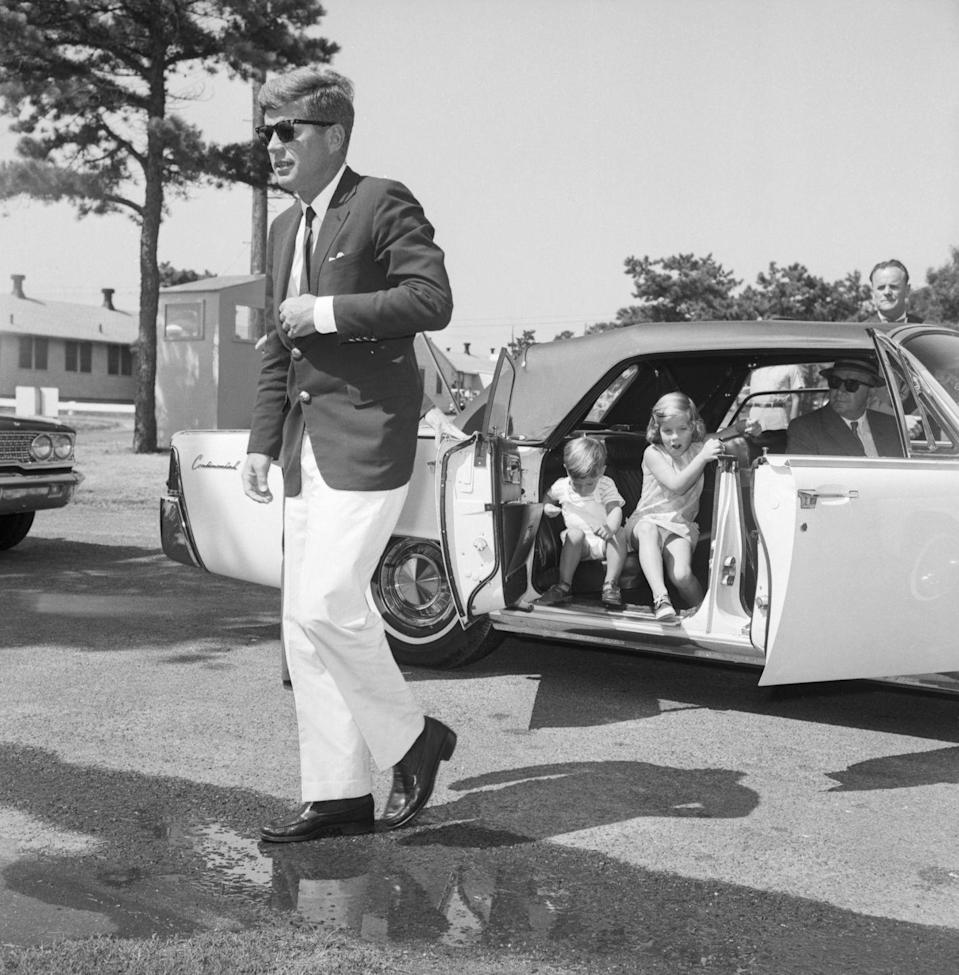 <p>President Kennedy with his two children, on their way to visit First Lady Jacqueline in the hospital. </p>