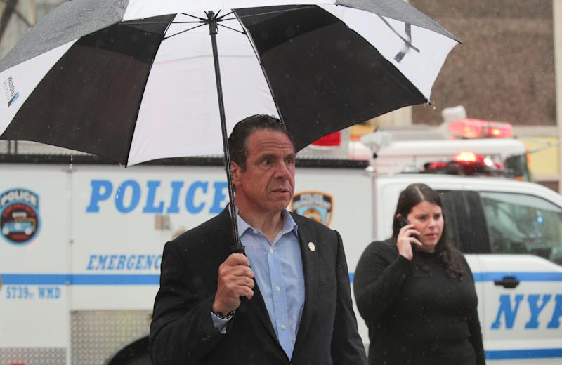 New York Governor Andrew Cuomo arrives at the scene after a helicopter crashed atop a building in Times Square and caused a fire in the Manhattan borough of New York, New York, New York City firefighters suit up at the scene after a helicopter crashed atop a building and caused a fire in the Manhattan borough of New York, New York, June 10, 2019. (Photo: Brendan McDermid/Reuters)