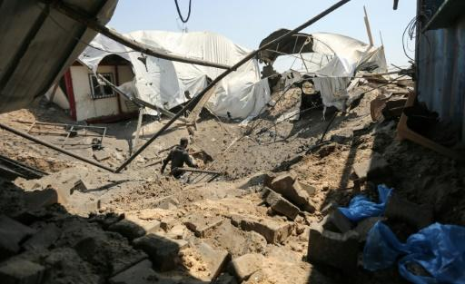 A man inspects the damage at a site targeted by an Israeli air strike in the southern Gaza strip