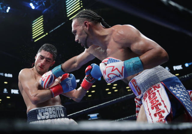 Keith Thurman, right, punches Josesito Lopez during the eighth round of a welterweight championship boxing match Saturday, Jan. 26, 2019, in New York. Thurman won the fight. (AP Photo/Frank Franklin II)