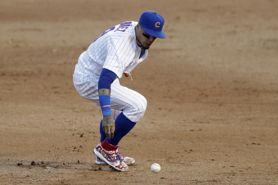 Chicago Cubs shortstop Javier Baez can't make the play on a single by Chicago White Sox's Adam Engel during the third inning of an exhibition baseball game at Wrigley Field in Chicago, Sunday, July 19, 2020. (AP Photo/Nam Y. Huh)