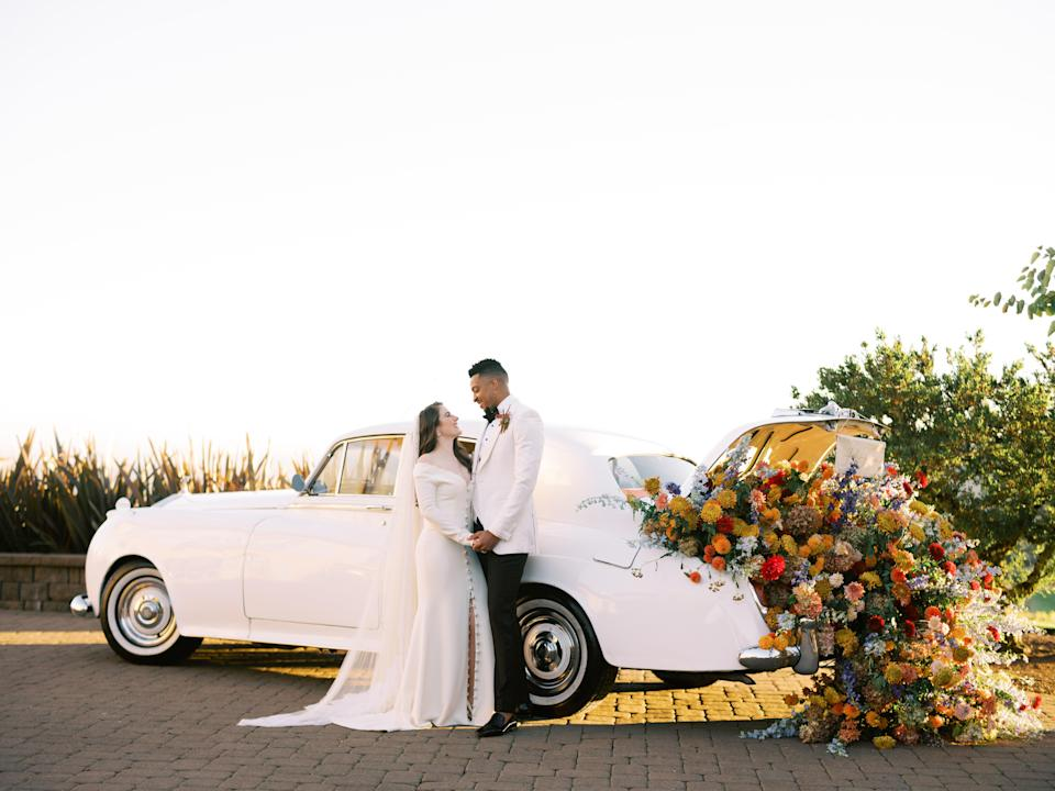 "If you know me, you know of my deep love and appreciation for flowers and nature. This vintage car with flowers spilling out of the trunk was created by <a href=""https://www.instagram.com/orenco.co/?hl=en"" rel=""nofollow noopener"" target=""_blank"" data-ylk=""slk:Oren Co."" class=""link rapid-noclick-resp"">Oren Co.</a> and <a href=""https://www.instagram.com/hart_floral/?hl=en"" rel=""nofollow noopener"" target=""_blank"" data-ylk=""slk:Hart Florals"" class=""link rapid-noclick-resp"">Hart Florals</a>, and it blew my mind."