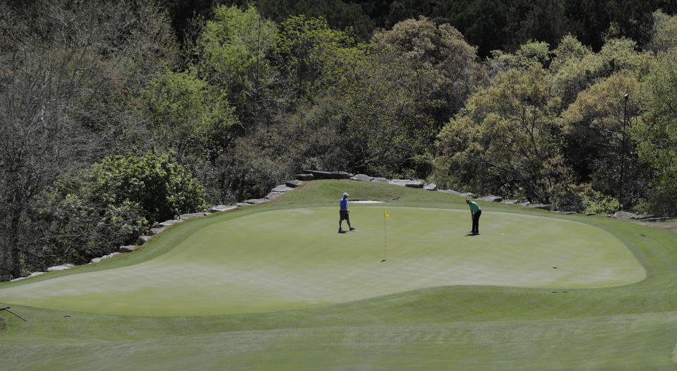 Ian Poulter, right, of England, putts on the second green during a practice round at the Dell Technologies Match Play golf tournament at the Austin Country Club, Tuesday, March 20, 2018, in Austin, Texas. (AP Photo/Eric Gay)