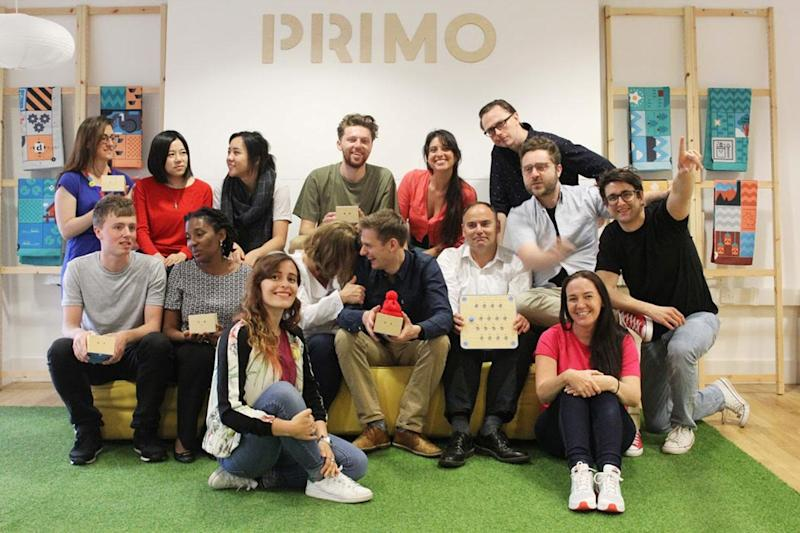 The Primo Toys team with Cubetto, its coding toy for children: Primo Toys