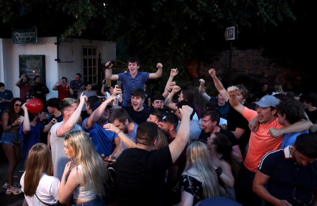Liverpool fans celebrate outside a pub in Liverpool after they are crowned Premier League champions after Manchester City lost 2-1 against Chelsea. (Photo by Peter Byrne/PA Images via Getty Images)