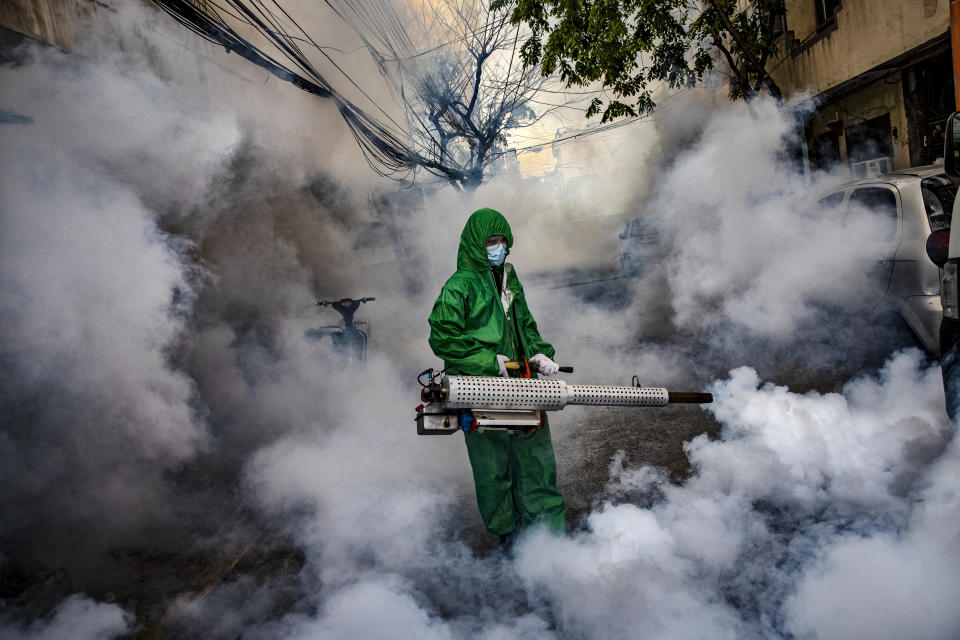 A worker wearing a hazmat suit uses a fogging machine to disinfect a street as preventive measure against COVID-19 on March 26, 2021 in Manila, Philippines. (Photo: Ezra Acayan/Getty Images)