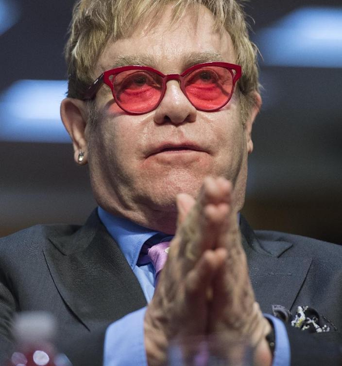 Singer Elton John, founder of the Elton John AIDS Foundation, testifies about global health programs during a Senate Appropriations Subcommittee hearing on Capitol Hill in Washington, DC, May 6, 2015 (AFP Photo/Saul Leob)