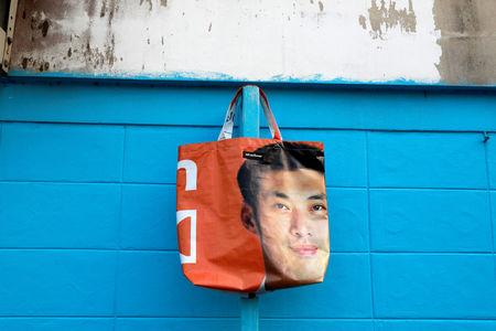 A tote bag made from an old election campaign poster is displayed for a photo on a street in Bangkok, Thailand April 8, 2019. REUTERS/Soe Zeya Tun