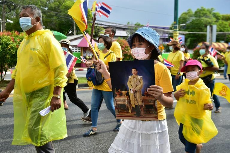 Pro-royalists have held portraits of Thailand's king during rallies in support of the monarchy