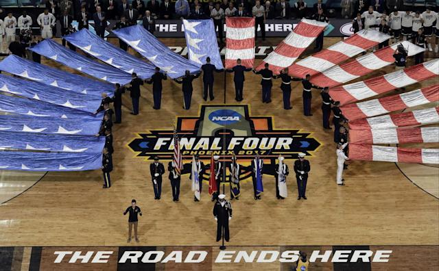 <p>The flag is displayed during the national anthem before the finals of the Final Four NCAA college basketball tournament, Monday, April 3, 2017, in Glendale, Ariz. (AP Photo/Morry Gash) </p>