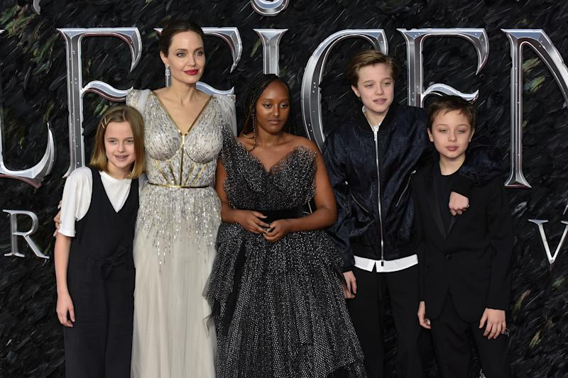 LONDON, UNITED KINGDOM - 2019/10/09: Vivienne Jolie-Pitt, Angelina Jolie, Zahara Jolie-Pitt, Shiloh Jolie-Pitt and Knox Leon Jolie-Pitt attend the Maleficent: Mistress of Evil European Premiere at the BFI IMAX Waterloo in London. (Photo by James Warren/SOPA Images/LightRocket via Getty Images)