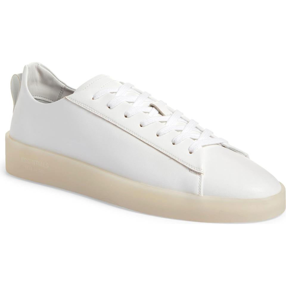 """<p><strong>Fear of God Essentials</strong></p><p>nordstrom.com</p><p><strong>$295.00</strong></p><p><a href=""""https://go.redirectingat.com?id=74968X1596630&url=https%3A%2F%2Fwww.nordstrom.com%2Fs%2Ffear-of-god-essentials-the-essential-tennis-low-sneaker-men%2F5926480&sref=https%3A%2F%2Fwww.esquire.com%2Fstyle%2Fmens-fashion%2Fg28186249%2Fbusiness-casual-shoes%2F"""" rel=""""nofollow noopener"""" target=""""_blank"""" data-ylk=""""slk:Shop Now"""" class=""""link rapid-noclick-resp"""">Shop Now</a></p><p>An ultra-versatile white sneaker with a little extra edge, courtesy of Jerry Lorenzo's Fear of God Essentials line.</p>"""