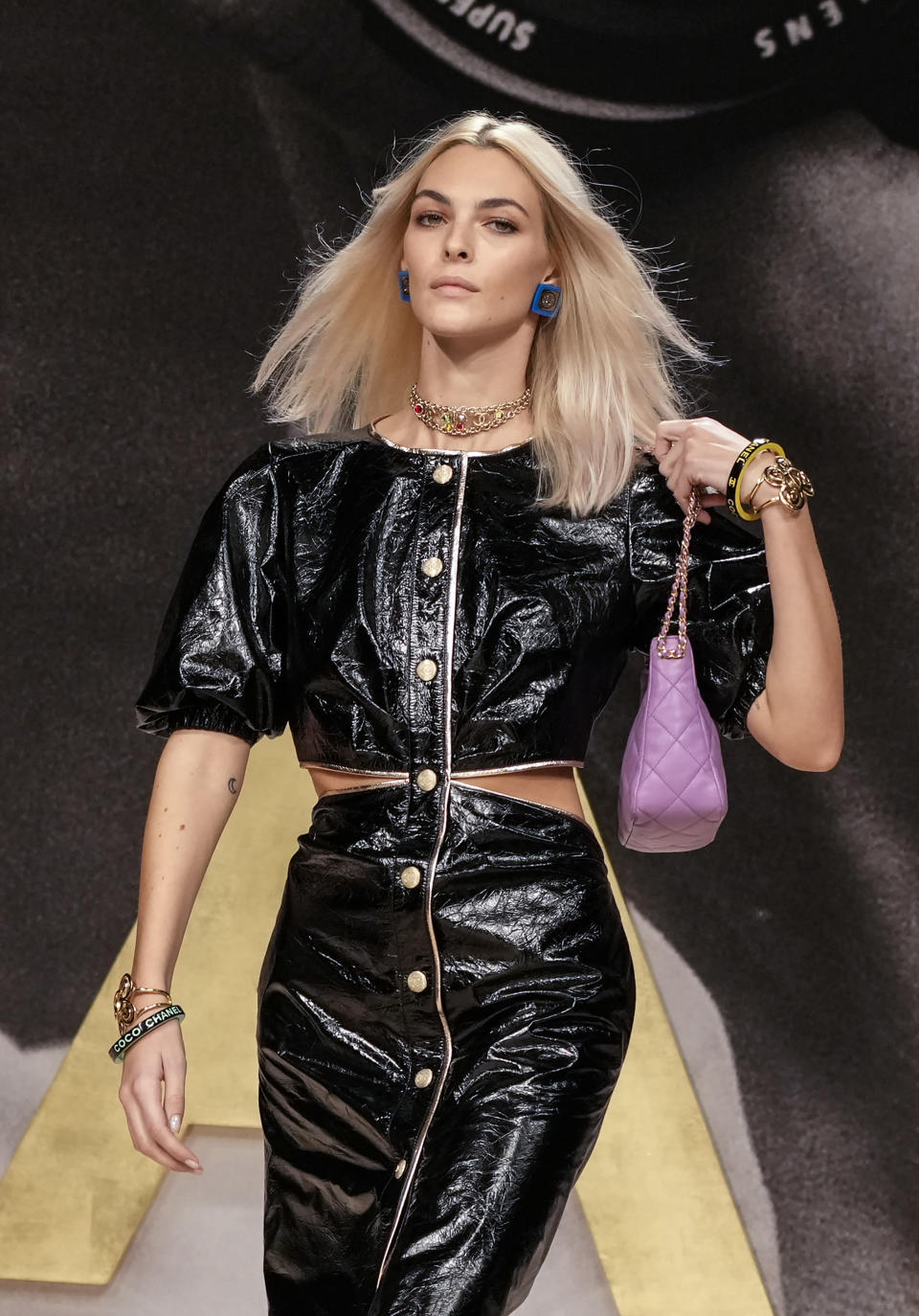 A model wears a creation for the Chanel Spring-Summer 2022 ready-to-wear fashion show presented Tuesday, Oct. 5, 2021, in Paris. (AP Photo/Francois Mori)
