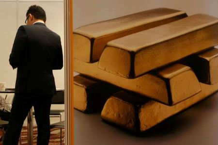 Gold edges up on rate cut bets, firmer equities limit upside