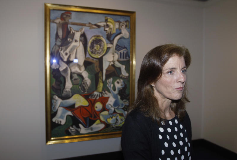 """Caroline Kennedy, president of the John F. Kennedy Library Foundation, unveils Pablo Picasso's painting """"Rape of the Sabine Women"""" at the JFK Library and Museum in Boston, Thursday, Oct. 4, 2012. The painting is on loan to the library from the Museum of Fine Arts in commemoration of the upcoming 50th anniversary of the Cuban Missile Crisis, which was Picasso's inspiration for the work. (AP Photo/Stephan Savoia)"""