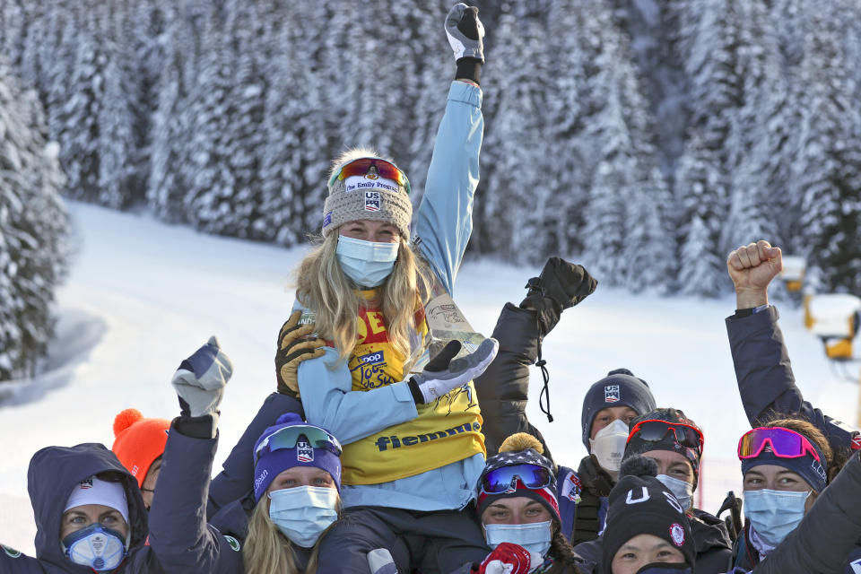 United States' Jessie Diggins celebrates after winning the women's cross-country Tour de Ski, in Val di Fiemme, Italy, Sunday, Jan. 10, 2021. (AP Photo/Alessandro Trovati)