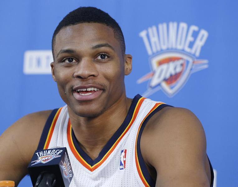 Oklahoma City Thunder guard Russell Westbrook smiles as he answers a question during a news conference during media day for the NBA basketball team in Oklahoma City, Friday, Sept. 27, 2013. (AP Photo/Sue Ogrocki)