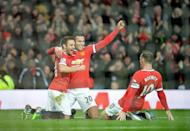 Dutch striker Robin van Persie (centre) celebrates with teammates Juan Mata and Wayne Rooney (right) during Manchester United's victory against Liverpool on December 14, 2014 (AFP Photo/Oli Scarff)
