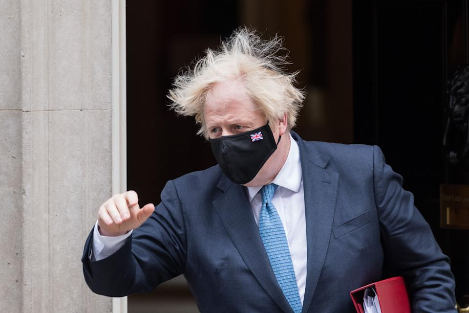LONDON, UNITED KINGDOM - JULY 14, 2021: British Prime Minister Boris Johnson leaves 10 Downing Street for PMQs at the House of Commons on July 14, 2021 in London, England. (Photo credit should read Wiktor Szymanowicz/Barcroft Media via Getty Images)