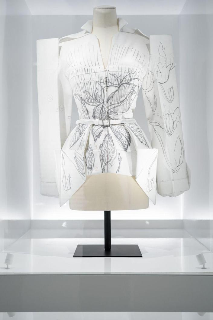 <p>The pattern of a couture design that represents the storied maison's bright-white atelier. </p>