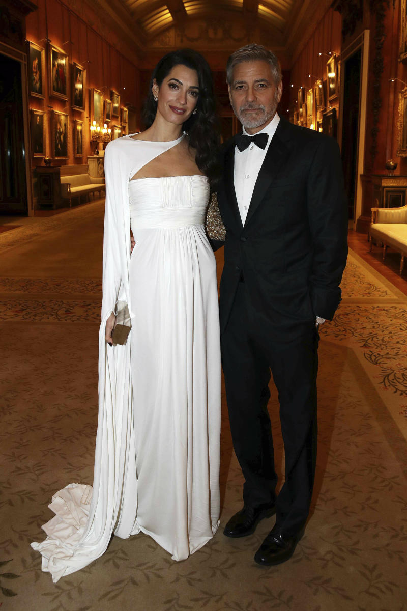 Amal and George Clooney attend a dinner to celebrate The Prince's Trust, hosted by Prince Charles, at Buckingham Palace on March 12 in London. (KGC-375/STAR MAX/IPx)