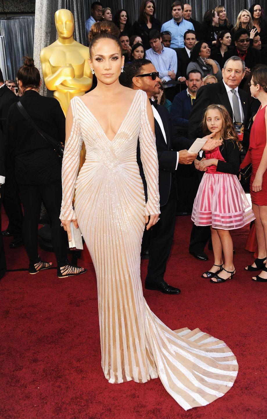 <p>J.Lo attends the Academy Awards in a plunging striped gown, which also has a major backless moment. Also, she's way ahead of the cold-shoulder trend! </p>
