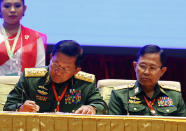 FILE - In this Feb. 13, 2018, file photo, Myanmar's Army Commander Senior Gen. Min Aung Hlaing, left, with Vice Senior Gen. Soe Win signs documents during a ceasefire agreement at the Myanmar International Convention Center in Naypyitaw, Myanmar. Two ethnic rebel groups have joined Myanmar's long-delayed peace process, a small step forward in ending decades of civil strife, but one that may not be significant. The future of the Myanmar's already-fragile peace process between the military, ethnic armed groups and militias is in question as the military regains control of the country after the Feb. 1, 2021 coup. (AP Photo/Aung Shine Oo, File)