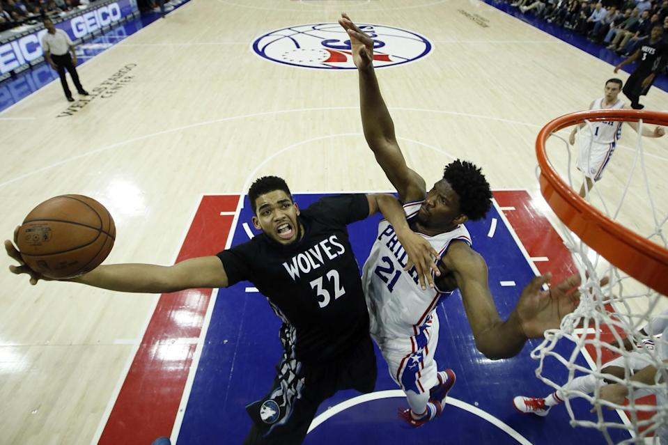 Minnesota's Karl-Anthony Towns, left, goes up for a shot against Philadelphia's Joel Embiid in a January game. (AP)