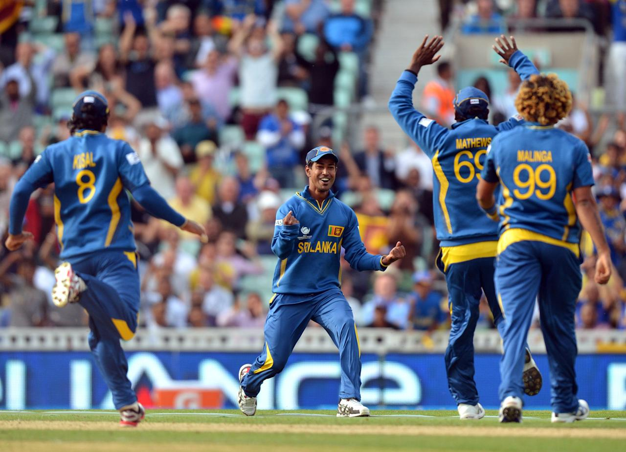 Sri Lanka's Nuwan Kulasekara (centre) celebrates running out Australia's captain George Bailey (not pictured) during the ICC Champions Trophy match at The Oval, London.