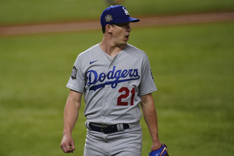 Los Angeles Dodgers starting pitcher Walker Buehler celebrates the end of the third inning against the Tampa Bay Rays in Game 3 of the baseball World Series Friday, Oct. 23, 2020, in Arlington, Texas. (AP Photo/Eric Gay)